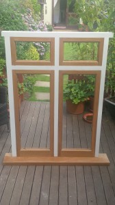 Solid Painted Sapele Hardwood Frames with American white oak fixed double glazed casement windows.